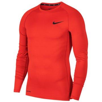 Nike SweatshirtsM NP TOP LS TIGHT - BV5588 rot